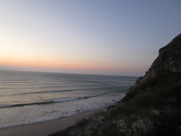 Watching the sun set over Watergate Bay